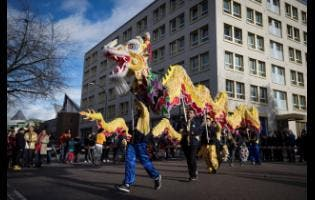 Dancers perform a dragon dance during the Chinese New Year Parade, in Vancouver, yesterday.
