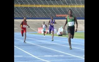 Calabar High School's Requel Reid approaches the finish line in the Class Four Boys 400m event at the Digicel Anthrick Corporate Area Development Meet at the National Stadium on Saturday.