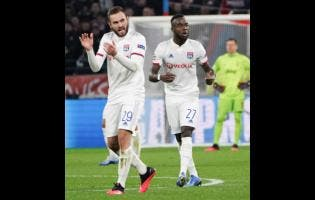 Lyon's Maxwel Cornet (right) celebrates with teammate Lucas Tousart who scored his side's winning goal during a round-of-16 first-leg match against Juventus at the Lyon Olympic Stadium yesterday.