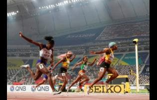Shelly-Ann Fraser-Pryce (6), of Jamaica, finishes ahead of Dina Asher-Smith (7), of Britain, and Marie-Josée Ta Lou (4), of The Ivory Coast, in the women's 100-metre final at the World Athletics Championships in Doha, Qatar, September 29, 2019.