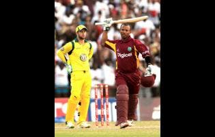 West Indies' Carlton Baugh celebrates after scoring the winning runs as Australia wicketkeeper Matthew Wade looks on during their second one day international cricket match in Kingstown, St Vincent, Sunday, March 18, 2012. West Indies won by five wickets with 10 balls remaining under the Duckworth/Lewis method.