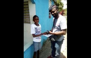Danique Lawrence, whose story appeared in the Thursday's STAR, receives her donation from entertainer Rising Sonn.