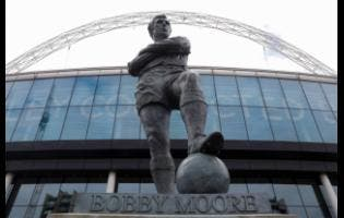 The statue of the late England player Bobby Moore outside Wembley Stadium in London.