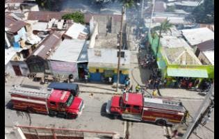 An aerial photograph of two fire trucks, parked on Charles Street, Kingston, responding to a fire on Pink Lane yesterday.