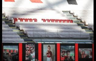 Jerseys to honor the victims of COVID-19 are placed in the stands during the Serie A match between AC Milan and Roma, at the San Siro Stadium in Milan, Sunday, June 28, 2020.