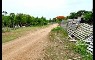 A section of the roadway in Treadlight, Clarendon, which will be rehabilitated at a cost of $150 million under the Jamaica Social Investment Fund's Integrated Community Development Project.