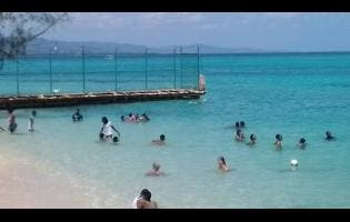 Beach goers make use of this Montego Bay beach.