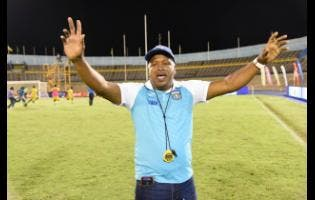 FILE Lenworth Hyde, coach of Clarendon College, celebrates after they defeated Jamaica College on penalties to win the Olivier Shield football title last year.