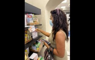 Courts customer Tanesha decides on what size food package to buy.