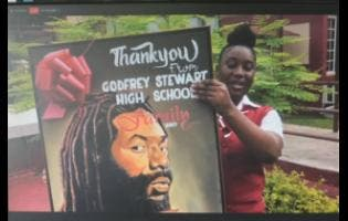 Jodiann Morris, female valedictorian of Godfrey Stewart High School's Class of 2020, holds up a portrait of reggae artiste Buju Banton via Zoom.