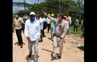 Minister of Tourism  Edmund Bartlett (left); and Minister without Portfolio in the Ministry of Economic Growth and Job Creation, Daryl Vaz, tour a section of Grange Pen in St James, recently.
