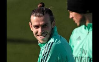 In this Monday, November 25, 2019 file photo, Real Madrid's Gareth Bale takes part in a training session at the team's Valdebebas training ground in Madrid, Spain.
