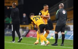 Wolverhampton Wanderers' Fernando Marcal is replaced by teammate Ruben Vinagre (left), during the English Premier League football match.