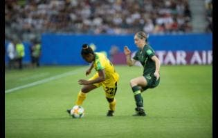 Reggae Girl Mireya Grey (left) turns neatly away from Australia's Karly Roestbakken during their group-stage match in the 2019 FIFA Women's World Cup in France.