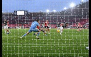 Manchester United's Edinson Cavani scores his side's third goal during an English Premier League match between Southampton and Manchester United at the St. Mary's stadium in Southampton, England, Sunday, November 29, 2020.