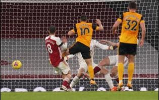 Wolverhampton Wanderers' Daniel Podence (second left) scores his team's second goal during the English Premier League match between Arsenal and Wolverhampton Wanderers at Emirates Stadium, London, yesterday.