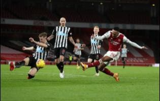 Arsenal's Pierre-Emerick Aubameyang scores his side's opening goal during the English Premier League match between Arsenal and Newcastle United at Emirates Stadium in London, England, yesterday.