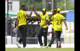 FILE Scorpions players Oshane Thomas and Rovman Powell celebrate the dismissal Monank Patel of the USA during the Group B match of the Windies Super50 Cup on Monday, October 8, 2018, at Kensington Oval.