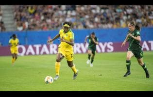 File Khadija Shaw (left) dribbles away from Australia's defender Karly Roestbakken in  a FIFA Women's World Cup first round match between Jamaica and Australia June 18, 2019.