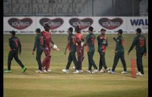 Bangladesh's players celebrate after wrapping up their third win in the three match One Day International series yesterday.