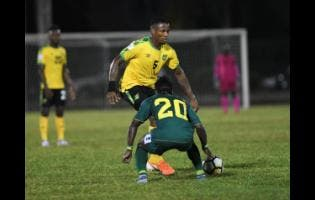 File Jamaica's Alvas Powell attempts to go past Guyana's Trayon Bobb during a Concacaf Nations League match at the Montego Bay Sports Complex on Novembert 18, 2019.