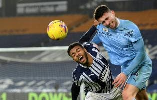 Manchester City's Aymeric Laporte (right) duels for the ball with West Bromwich Albion's Hal Robson-Kanu during the English Premier League match between West Bromwich Albion and Manchester City at the Hawthorns stadium in West Bromwich, England, yesterday.