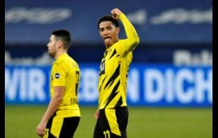 Dortmund's Jude Bellingham celebrates at the end of the German Bundesliga soccer match against  FC Schalke 04  in Gelsenkirchen, Germany, on Saturday, February 20.