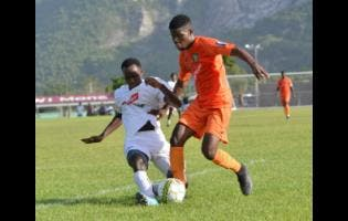 File UWI FC player Andre Humphrey (right) tackles  Tivoli Gardens' Junior McGregor during Red Stripe Premier League encounter in 2019.