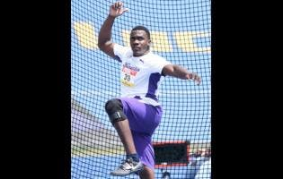 Kingston College's Ralford Mullings, winner of the Class One Boys discus throw final.