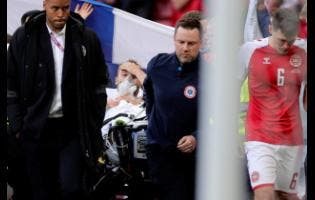 Paramedics using a stretcher to take Denmark's Christian Eriksen off the field after he collapsed during the Euro 2020 Group B match between Denmark and Finland at Parken stadium in Copenhagen, Denmark, last Saturday.