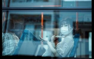 A woman sits on a bus yesterday in Mishima, Japan, a day before the start of the Olympic Games.