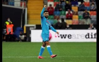 Napoli's Lorenzo Insigne celebrates after scoring the first goal of the game during the Serie A  match between Udinese and Napoli, at the Dacia arena in Udine, Italy, yesterday.