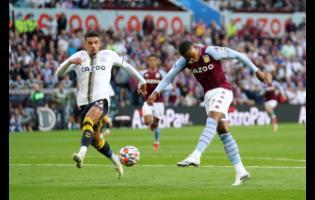 Aston Villa's Leon Bailey (right) scores during the English Premier League match between Aston Villa and Everton at Villa Park, Birmingham, England, on Saturday, September 18, 2021.