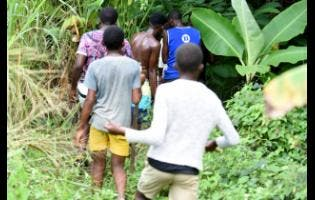 Young boys join in the search  for Winshae Barrett, one of the St Thomas children who was abducted. She was found alive.