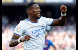 Real Madrid's David Alaba celebrates after scoring his sides first goal during the Spanish La Liga match against FC Barcelona at the Camp Nou stadium in Barcelona, Spain, yesterday.