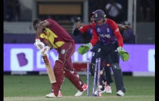 West Indies' Andre Russell is clean bowled by England's Adil Rashid during the T20 World Cup match between England and the West Indies at the Dubai International Cricket Stadium last Saturday.