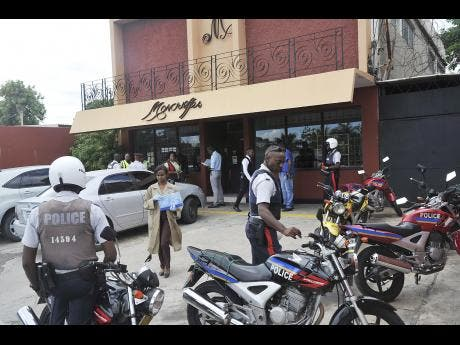 Police Gather Outside Moncrieffeu0027s Patio Shop On Old Hope Road In St Andrew  Last Friday After The Murder.