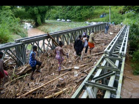 Rain, rain go away ... Jamaicans suffer from heavy rains, flooding