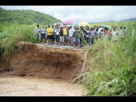 Rain, rain go away ... Jamaicans suffer from heavy rains, flooding