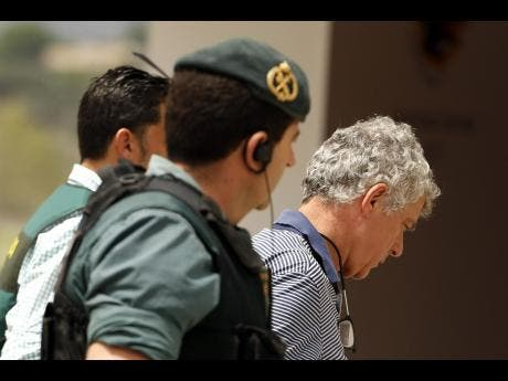 Police arrest Spanish football federation president and son
