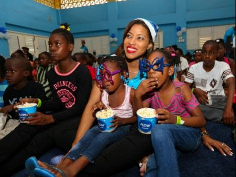 kayon wallace director of corporate communications and stakeholder engagement at flow centre enjoys the movie with camelia oldfield left and justina - Christmas Magic Movie