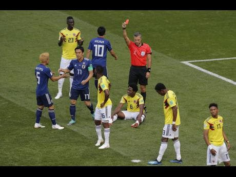 Japan make history with win against 10 man Colombia
