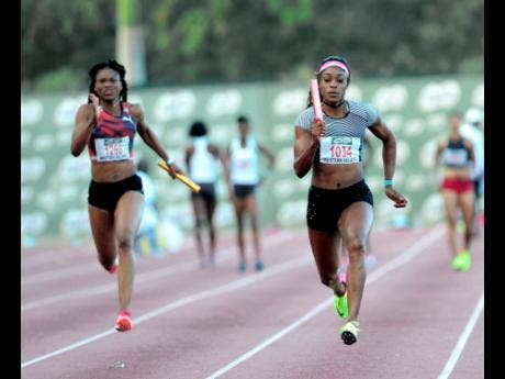 Elaine Thompson (right) anchoring the MVP Track Club team to victory in the women's 4x100m event at the Milo Western Relays at the Montego Bay Sports Complex on Saturday, February 2, 2017. To her right is Ristananna Tracey, formerly of the Sprintec Track Club. Sports Minister Olivia Grange says upgrades are being planned for the running track at the stadium.