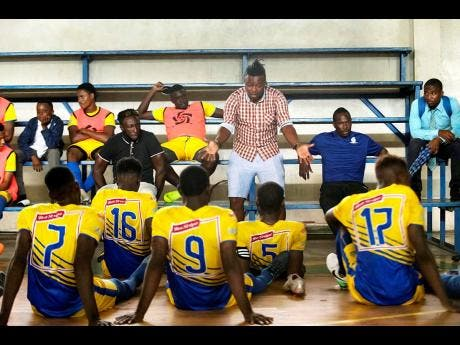 File Harbour View FC head coach Fabian Taylor (standing) speaks with his team at half-time during their Red Stripe Premier League game with UWI Football Club at the UWI Mona Bowl in St Andrew on Wednesday, January 9, 2019. Harbour View won 1-0.