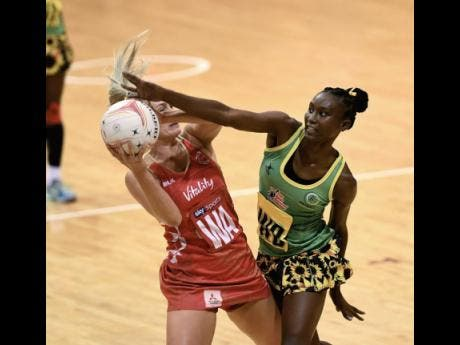 File England's wing attack Chelsea Pitman (left) comes under pressure from Jamaica's wing defender Jodiann Ward during the third and final game in their Lasco Sunshine Series at the National Indoor Sports Centre on October 15, 2018.