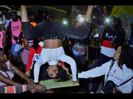 Anthony Minott photos  Dancing Rebel balances on her head top.