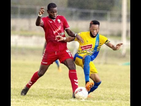 UWI FC's Dwayne Smith (left) tackles Odane Samuels of Harbour View FC during their Red Stripe Premier League match held at the UWI Mona Bowl in St Andrew on Wednesday, January 9.