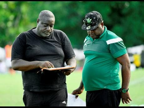 Humble Lion head coach Glendon 'Admiral' Bailey and his assistant Lijyasu Simms discuss tactics during a Red Stripe Premier League game at the Effortville Community Centre on Sunday, October 21, 2018.