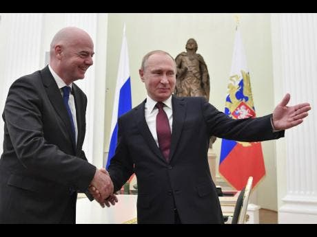 AP Russian President Vladimir Putin (right) welcomes FIFA President Gianni Infantino for talks in the Kremlin in Moscow, Russia, yesterday.