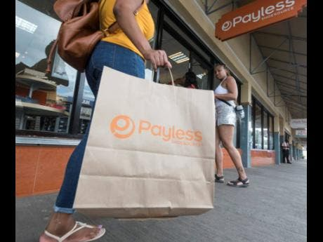 A Payless customer in the Springs Plaza located on Constant Spring Road in Kingston on Saturday, February 15.